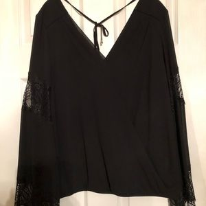 Black blouse w/ tie back and lace sleeves. Size XL